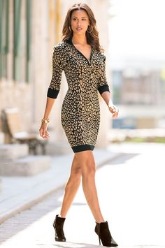 Sexy and fierce, this cozy sweater dress has a partial front zip with a contrasting collar and banded hem and cuffs. Add a pair of strappy heels or booties and you