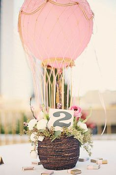 Get creative, and make mini hot air balloons for a cute centerpiece. Source: Logan Cole Wedding Co.