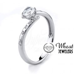 Bypass Round Diamond Engagement Ring with Spaced Out Diamond Accents #engagementring