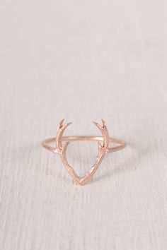 """This dainty ring features a textured brushed metal, thin band, with a small open antler design. Non adjustable band. Measurement Measures approx. 0.6"""" L x 0.75"""" D."""