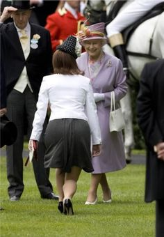 Not a very flattering view of Eugenie mid-curtsy, but I love the happy smile on her granny's face!