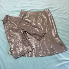 Talbots 2 piece skirt and jacket set Skirt is a size 6p. Jacket is a size 4p. Only worn once. Very good condition. Color is brown with silver. High quality material. Talbots Skirts Skirt Sets