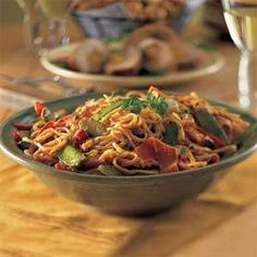 This dish comes together quickly when one person prepares the sauce while another sautés the vegetables. Break the pasta in half before...