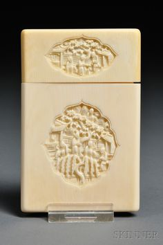 Ivory Card Case, China, 19th century, rectangular, carved on each side with a central cartouche depicting figures at leisure in a garden scene, the cover similarly decorated, 4 1/2 x 2 7/8 x 1/4 in.