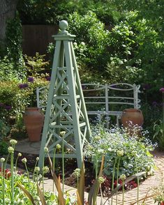 Love garden obelisks!- quite like this paint colour