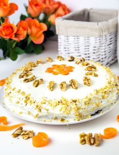 Moist and delicious cinnamon, zucchini carrot cake with a delicious cream cheese cream frosting, topped with chopped walnuts