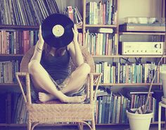 Vinyl, books, and record player.
