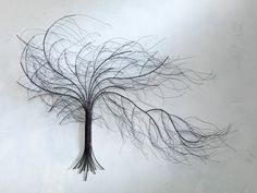 "The ""windswept tree"" is captured in this metal sculpture...it really looks like wispy branches instead of metal!"