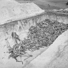 The horrific debris of Nazi Europe: Partially filled mass grave at Bergen-Belsen after the camp was liberated by the British.