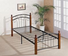 """3ft Venice Metal Bed Frame - £99.95 - A popular traditional looking bed frame with ornate black metal matching head and low footend, finished with solid 3"""" turned wooden posts and a steel base. The base is a two part design which is very easy to assemble (allen key provided). The posts are a dark mahogany colour with a laquered finish."""