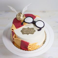 Harry Potter themed cake with the golden snitch.  Love this for a kids birthday cake or a baby shower!