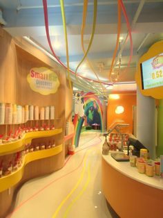 The moment you enter the Yooglers Frozen Yogurt shop in NYC, you're met with wonderful, bright, rainbow colors from ceiling to floor!