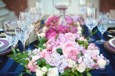 Lush pink florals against gorgeous navy blue linens.  Photo by Ely Fair Photography.  www.wedsociety.com  #wedding #centerpieces
