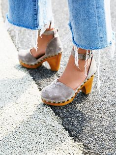 Daubs Clog | Suede clogs with a wooden heel and metal stud detailing. Buckle ankle strap and stitch detail on toe.