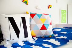 Love the blue clouds duvet cover and the geometric pillow for an added burst of colour