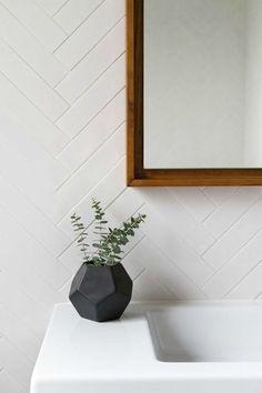 Modern bathroom features walls clad in a white herringbone tiles, EliteTile Retro x Polished Soho Subway Porcelain Field Tile in White, Bathroom Decor Attic Bathroom, Laundry In Bathroom, Bathroom Interior, Bathroom Gray, Master Bathroom, White Bathrooms, Bathroom Fixtures, Bathroom Feature Wall Tile, Chevron Bathroom