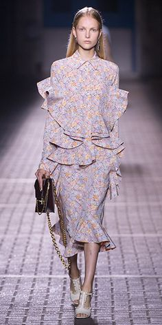 Mulberry Summer '17 LFW show. Anneli blouse in lilac crepe de chine large flower print, Aya skirt in lilac crepe de chine large flower print, Frills t-bar sandal 100 in butter glossy calf, Pembroke clutch in burgundy grainy patent leather and Stone single earrings in crystal brass & silver tone metal.