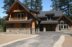 Boasting porches and patios both in front and back, this rustic lodge encourages you to enjoy the great outdoors.The masterfully designed open floor plan lets you take full advantage of the views from all the main rooms. Rustic House Plans, Craftsman Style House Plans, Architectural Design House Plans, Architecture Design, Architectural Styles, Style At Home, Mountain House Plans, Mountain Homes, Mountain Living