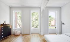 The restoration of this New York Brownstone saw floors replaced, windows reinstalled, doors reb...