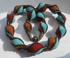 """Crochet Beads-burn """"truffle candy"""" having struggled unsuccessfully to learn bead crochet new forms of it amaze me! Knitted Necklace, Beaded Necklace, Beaded Bracelets, Beaded Jewelry Patterns, Beading Patterns, Beaded Jewellery, Seed Bead Crafts, Free Beading Tutorials, Bead Crochet Rope"""