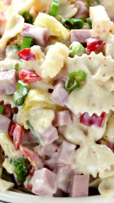Hawaiian Pasta Salad ~ Literally one of the most delicious cold pasta salad recipes... Pasta combined with ham and sweet pineapple and tossed with a delicious homemade dressing is the perfect combination!