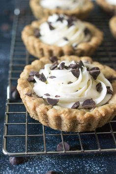 Adorable mini tarts made with chocolate chip cookie dough, then filled with a sweet vanilla buttercream.