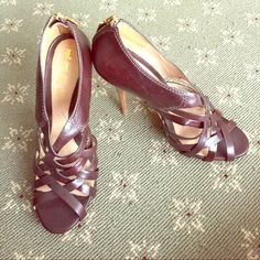 L.A.M.B. Strapped  chocolate leather heels  Gwen Stefani made these gorgeous leather heels with a leather sole. They have strap leather lines that crisscross down your foot into a peep toe. Worn for fifteen minutes guaranteed. They are in mint condition. Xox L.A.M.B. Shoes Heels