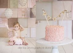 """Shabby chic cake smash first birthday.  Backdrop is made from 12x12 scrapbook papers, hanging balloons are paper mache covered with circles of book pages and little jars as the """"baskets"""""""