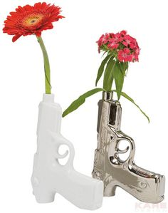 Out-of-the-ordinary vase with a revolver look which comes in peace, however. The barrel provides enough space for the water supply to the flowers. Available in white and silver.