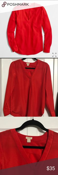 J. Crew V-Neck Silk Blouse Brand new with tags silk blouse from J. Crew. Delicate cut out pattern at neckline. Perfect as a work blouse tucked into a pencil skirt or with slacks and to wear casually with skinny jeans. J. Crew Tops Blouses