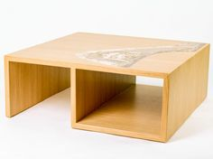Nastro Small table and container element. It features a bearing surface and a container compartment. The materials of which it is made are completely natural, wood and Malta di Geris (Mortar of Geris), with full respect of the concept of eco-design.