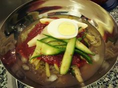 Naeng Myeon - Cold Noodle Soup.  This is my absolutely favorite Korean dish.  My mom still makes me this to take to work for lunch.