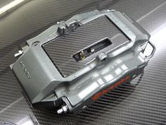 iPhone 5 Brembo brake caliper dock. Real carbon fibre mounting. Ready for order now. mike@oakleydesignlondon.com