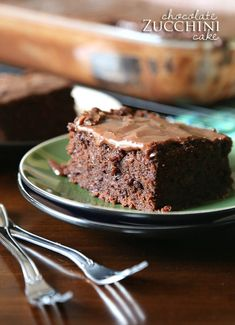 Chocolate Zucchini Cake...a rich , dense chocolate cake made with shredded zucchini. It's topped with a poured chocolate frosting that melts...