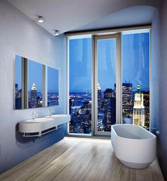Jaw dropping city views from this penthouse master bathroom  Follow @michael_louis_ for more! #ModernMansions