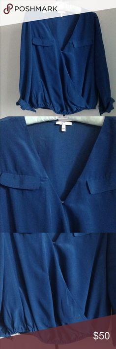 "DESIGNER: JOIE Istanbul' Surplice Silk Blouse Details - Color is called ""Mallard Blue"" in this Wrap Style Blouse - Hook & Eye Closure; Bust Pockets - Two Buttons on Cuffs of Sleeves - Elastic Waist - Size XS - Approx. 22"" length, 14.5"" @ elastic waist, 17.5"" Flat Pit to Pit - In Great Condition, a Nordstrom Purchase  Fiber Content: 100% Silk Joie Tops Blouses"