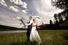 A bow hunting bride at her country themed wedding. Love creating these dramatic wedding photos!  Spokane Wedding Photographer Crystal Madsen Photography