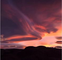 Photo 2 Crazy well defined red ‪#‎lenticular‬ clouds over Patagonia Ice Cap near El Chalten, Argentina a few days ago! Incredible! These stationary lens shaped clouds often occur over mountain areas with perpendicular alignment to the wind direction.  Have you ever seen any?  Photo's by Michael Clark.