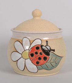 handmade ceramic sugar pot with beautiful ladybird motif hand thrown on a potter's wheel and hand painted the perfect pot to serve your sugar in also great for storing all sorts of nick-nacks would make a nice gift or just a. Flower Pot Crafts, Flower Pots, Painted Rocks, Hand Painted, Sugar Pot, Ceramic Cookie Jar, Pottery Animals, Pottery Painting, Clay Pots