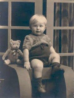 Vintage photo of sweet little boy with his Teddy bear circa 1920 - 1940.