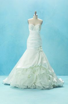 A wedding dress inspired by Disney's Princess and the Frog. The crystal sweetheart neckline stole my heart.