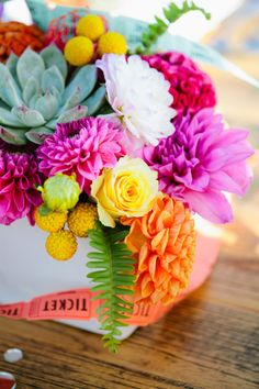 Beautiful bright flowers: http://www.stylemepretty.com/california-weddings/santa-monica/2015/01/23/colorful-santa-monica-pier-wedding-inspiration/ | Photography: Sorella Muse - http://www.sorella-muse.com/