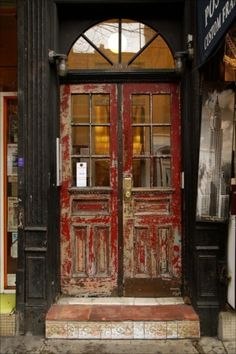 aged red double doors, fan lite above-- perfect!