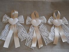 lace ribbon bow with tails, other colored silk ribbon folded in half(creating a loop) glue and accented with heart(or other decoration) Wedding Gifts For Guests, Wedding Favours, Diy Wedding, Christmas Bows, Christmas Crafts, Bridal Shower Decorations, Wedding Decorations, Diy And Crafts, Crafts For Kids