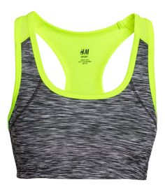 Sports bra in fast-drying functional fabric with a mesh racer back, lined front, and elasticized lower edge. Medium support.  | H&M Sport