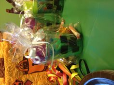 "Minecraft party favor: Creeper ""cup"" made with Sharpie, square candies, Red square ""red stone"" lollipop,  can of Silly String for ""spider webs"", packets of pumpkin and watermelon seeds,  and small block puzzle from dollar store."