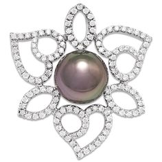 "Tahitian Black Pearl ""Fancy Freeform Heart"" Pendant with Diamonds:: A 14K white-gold pendant set with one semi-round Tahitian Pearl, 10-11mm and blackish in color, and one-hundred and twenty-six faceted round Diamonds totaling 0.752 carats, total weight, in a ""Freeform Heart"" design, without chain."