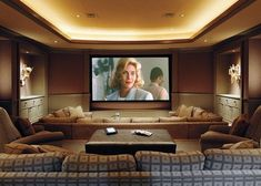 Basement home theater ideas, DIY, small spaces, budget, medium, inspiration, built ins, paint colors, garage, film reels, projects, wall art, projection screen, hardwood floors, tips and crown #hometheatertips