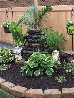 Waterfall garden at hose in back Tropical Landscaping, Landscaping With Rocks, Landscaping Plants, Outdoor Landscaping, Front Yard Landscaping, Garden Landscape Design, Small Garden Design, Small Gardens, Outdoor Gardens
