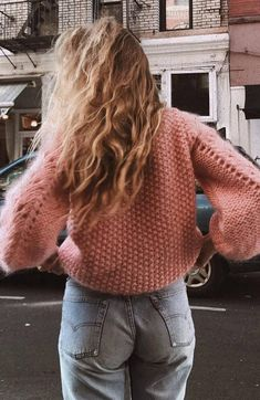 pink sweater and jeans